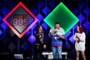 (L-R) Rose, Intern John, and Riley of Hot 99.5 perform onstage during HOT 99.5's Jingle Ball 2019 on December 16, 2019 in Washington, DC.