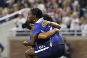 Crystal Dunn #25 of the United States jumps into the arms of Ali Krieger #11 of the United States after scoring a goal against Haiti during the second half of the U.S. Women's 2015 World Cup victory tour match at Ford Field on September 17, 2015 in Detroit, Michigan. The US defeated Haiti 5-0.