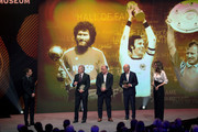 Philipp Lahm, Paul Breitner, Andreas Brehme and Franz Beckenbauer are seen on stage the Hall Of Fame gala at Deutsches Fussballmuseum on April 01, 2019 in Dortmund, Germany.