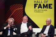 Sepp Maier, Andreas Brehme and Franz Beckenbauer are seen on stage the Hall Of Fame gala at Deutsches Fussballmuseum on April 01, 2019 in Dortmund, Germany.