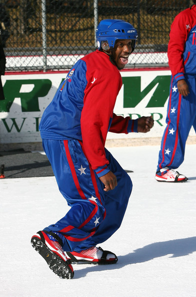 Rocket Rivers Rocket Rivers of the Harlem Globetrotters performs during a game against the Washington Generals at Lasker Rink in Central Park on February 9, 2010 in New York City. The Harlem Globetrotters are said to be the first professional basketball team in history to play a game of hoops on ice.