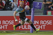 Mike Brown of Harlequins runs in to score his sides first try during the European Rugby Challenge Cup match between Harlequins and Agen at Twickenham Stoop on October 13, 2018 in London, United Kingdom.