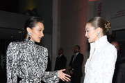 (EDITORIAL USE ONLY) (L to R) Bella Hadid and Gigi Hadid attend the Harper's Bazaar Exhibition as part of the Paris Fashion Week Womenswear Fall/Winter 2020/2021 At Musee Des Arts Decoratifs on February 26, 2020 in Paris, France.