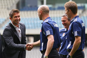 Australian football player Harry Kewell is greeted by assistant coach Kevin Muscat and captain Adrian Leijer during a press conference at Etihad Stadium on September 12, 2011 in Melbourne, Australia. Kewell has signed a three year deal to play with the Melbourne Victory A-League club beginning this season.