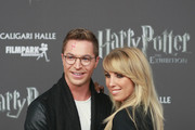 Annemarie Eilfeld and Julian David attend the 'Harry Potter: The Exhibition' VIP opening at Filmpark Babelsberg on October 12, 2018 in Potsdam, Germany.