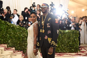 Kesha Ward and 2 Chainz attend the Heavenly Bodies: Fashion & The Catholic Imagination Costume Institute Gala at The Metropolitan Museum of Art on May 7, 2018 in New York City.