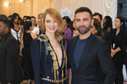 Emma Stone and designer Nicolas Ghesquiere attend the Heavenly Bodies: Fashion & The Catholic Imagination Costume Institute Gala at The Metropolitan Museum of Art on May 7, 2018 in New York City.