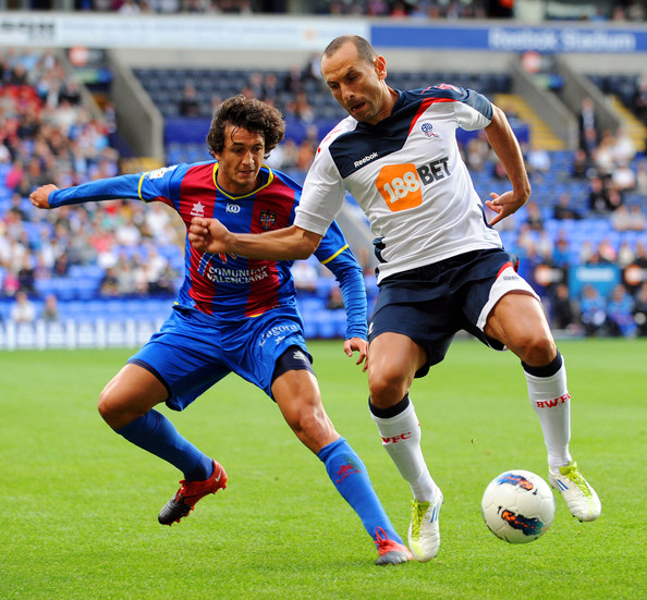 Hector Rodas Martin Petrov (R) of Bolton is put under pressure by Hector Rodas of Levante during the pre season friendly match between Bolton Wanderers and Levante at the Reebok Stadium on August 05, 2011 in Bolton, England.