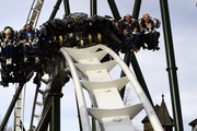 In the first row Melanie Mueller, Manuel Cortez, Christian Tews and Claudia Effenberg, in the second row Lucia Effenberg, Lukas Sauer and Thomas Strunz are pictured during the opening of the new wing coaster 'Flug der Daemonen' at Heidepark on March 20, 2014 in Soltau, Germany.