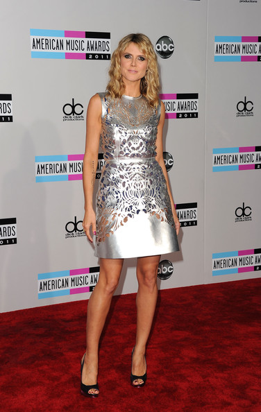 Heidi Klum TV personality Heidi Klum arrives at the 2011 American Music Awards held at Nokia Theatre L.A. LIVE on November 20, 2011 in Los Angeles, California.