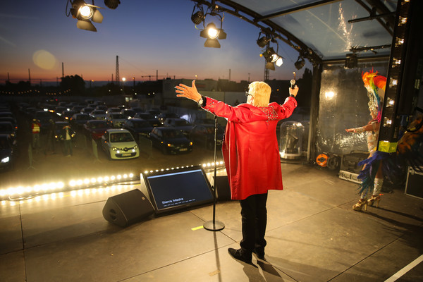 Heino Performs At BonnLive Drive-In Concert [performance,event,photography,performance art,performing arts,cars,heino performs,attendees,bonnlive autokonzerte,stage,concerts,german,bonnlive drive-in concert,concert,coronavirus crisis,lighting]
