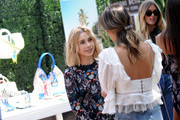 Olesya Rulin and Jamie Chung attend the Henri Bendel Surf Sport 2018 Collection Launch at The Bungalow on April 27, 2018 in Santa Monica, California.