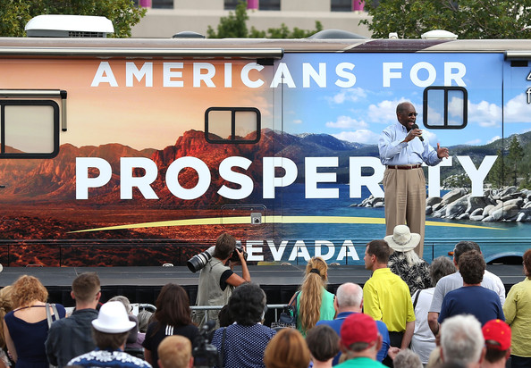 Herman Cain Attends Americans For Prosperity Rally Against President Obama