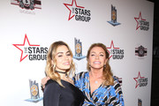 Sophie Simmons (L) and Shannon Simmons attend Heroes For Heroes: Los Angeles Police Memorial Foundation Celebrity Poker Tournament at Avalon Hollywood on November 10, 2018 in Los Angeles, California.