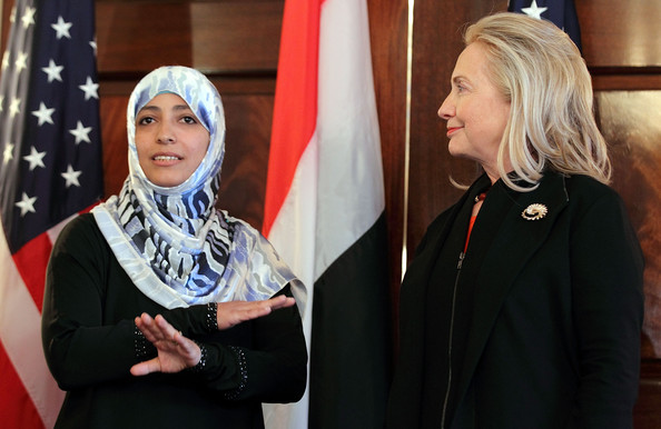 Hillary Clinton Yemeni Nobel Prize Winner Tawakkul Karman (L) speaks to the media as U.S. Secretary of State Hillary Clinton (R) looks on after their meeting October 28, 2011 at the State Department in Washington, DC. Karman, a journalist, human rights activist, and a politician, was the co-recipient of the 2011 Nobel Peace Prize.
