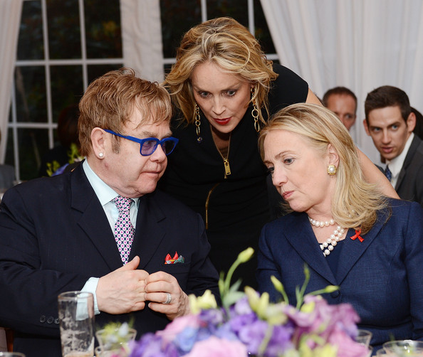The Human Rights Campaign, The Global Equity Fund and The Elton John AIDS Foundation Honor Secretary of State Hillary Clinton and Sir Elton John - Inside [facial expression,event,lady,fashion,fun,human,smile,blond,suit,floristry,hillary clinton,elton john,elton john aids foundation honor,elton john - inside,sharon stone,the global equity fund,coverage,l-r,private residence,human rights campaign]