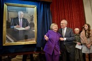 Former US Secretary of State Hillary Clinton reacts as Senate Minority Leader Senator Harry Reid (D-NV) poses her after revealing a portrait of himself during ceremony for the outgoing Senator on Capitol Hill December 8, 2016 in Washington, DC. / AFP / Brendan Smialowski