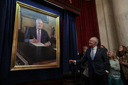 U.S. Senate Minority Leader Sen. Harry Reid (D-NV) admires his leadership portrait as he unveils it December 8, 2016 on Capitol Hill in Washington, DC. The leadership portrait unveiling ceremony was held to honor the outgoing Democratic leader.