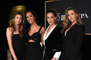 2018 Golden Globe ambassador Simone Alexandra Johnson (2nd-L) and 2017 honorees Sophia, Sistine and Scarlet Stallone attend the Hollywood Foreign Press Association (HFPA) and InStyle celebration of the 75th Annual Golden Globe Awards season at Catch LA in  West Hollywood, on November 15, 2017. / AFP PHOTO / CHRIS DELMAS