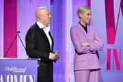 (L-R) Partner at CAA Bryan Lourd and actor-producer Charlize Theron are seen onstage during The Hollywood Reporter's Power 100 Women in Entertainment at Milk Studios on December 11, 2019 in Hollywood, California.