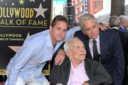 Cameron Douglas, Kirk Douglas, and Michael Douglas pose for a photo at the Hollywood Walk of Fame Ceremony Honoring Michael Douglas on Hollywood Boulevard on November 06, 2018 in Hollywood, California.