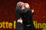 (L-R) Charlotte Rampling and Liliana Cavani hug each other on stage at the Homage Charlotte Rampling Honorary Golden Bear award ceremony during the 69th Berlinale International Film Festival Berlin at Berlinale Palace on February 14, 2019 in Berlin, Germany. Rampling is this years recipient of the Honorary Golden Bear Award of the Berlinale.