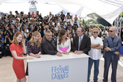 "(L-R) Actor Miranda Otto, producer Luc Besson, actors Sonja Richter, Hilary Swank, Tommy Lee Jones, producers Michael Fitzgerald and Brian Kennedy attend ""The Homesman"" photocall during the 67th Annual Cannes Film Festival on May 18, 2014 in Cannes, France."