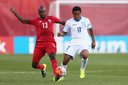 Adolfo Machado #13 of Panama and Andy Najar #17 of Honduras compate for the ball during the 2015 CONCACAF Gold Cup match between Honduras and Panama at Gillette Stadium on July 10, 2015 in Foxboro, Massachusetts.