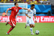 Andy Najar of Honduras controls the ball as Admir Mehmedi of Switzerland gives chase during the 2014 FIFA World Cup Brazil Group E match between Honduras and Switzerland at Arena Amazonia on June 25, 2014 in Manaus, Brazil.