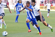 Andy Najar #19 of Honduras looks to take a shot as Omar Gonzalez #3 of the United States gives chase during the first half of a World Cup qualifying match on June 18, 2013 at Rio Tinto Stadium in Sandy, Utah.