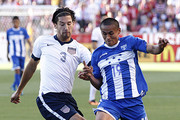 Omar Gonzalez #3 of the United States and Andy Najar #19 of Honduras fight for the ball during the first half of a World Cup qualifying match on June 18, 2013 at Rio Tinto Stadium in Sandy, Utah.