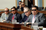 "(R-L) Rep. Blake Farenthold (R-TX), Rep. George Holding (R-GA), Rep. Ron DeSantis (R-FL) and Rep. Jason Smith (R-MO), join othermembers of the House Courts, Intellectual Property and the Internet Subcommittee in wearing 3D glasses while watching a demonstration of 3D technology on Capitol Hill July 25, 2013 in Washington, DC. The subcommittee, a part of the House Judiciary Committee, heard testimony on the topic of ""Innovation in America: The Role of Copyrights."""