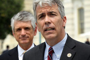 """U.S. Rep. Joe Walsh (R-IL) (R) speaks as Rep. Scott Rigell (R-VA) (L) listens during a news conference to announce the formation of the 'Fix Congress Now Caucus' May 16, 2012 on Capitol Hill in Washington, DC. A group of bi-partisan congressional members have formed the caucus hoping to """"prohibit members of Congress from receiving pay after October 1 for any fiscal year in which Congress has not approved a concurrent resolution on the budget and passed the regular appropriations bills."""""""