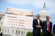 """U.S. Rep. Scott Rigell (R-VA) (L) and Rep. Joe Walsh (R-IL) (R) listen during a news conference to announce the formation of the 'Fix Congress Now Caucus' May 16, 2012 on Capitol Hill in Washington, DC. A group of bi-partisan congressional members have form the caucus hoping to """"prohibit members of Congress from receiving pay after October 1 for any fiscal year in which Congress has not approved a concurrent resolution on the budget and passed the regular appropriations bills."""""""