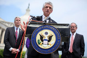 """U.S. Rep. Scott Rigell (R-VA) (C) speaks as Rep. Joe Walsh (R-IL) (L) and Rep. Jim Cooper (D-TN) (R) look on during a news conference to announce the formation of the 'Fix Congress Now Caucus' May 16, 2012 on Capitol Hill in Washington, DC. A group of bi-partisan congressional members have form the caucus hoping to """"prohibit members of Congress from receiving pay after October 1 for any fiscal year in which Congress has not approved a concurrent resolution on the budget and passed the regular appropriations bills."""""""
