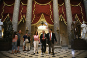 U.S. Rep. Steve King (R-IA) (R) and Rep. Michele Bachmann (R-MN) (L) pass through the Statuary Hall after a vote on the floor August 1, 2014 on Capitol Hill in Washington, DC. The House came back on Friday, a day after its scheduled summer recess, trying to finish up a border supplemental spending bill that was pulled from the floor the day before because of a shortage of votes.