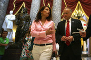 U.S. Rep. Steve King (R-IA) (R) and Rep. Michele Bachmann (R-MN) (2nd R) pass through the Statuary Hall after a vote on the floor August 1, 2014 on Capitol Hill in Washington, DC. The House came back on Friday, a day after its scheduled summer recess, trying to finish up a border supplemental spending bill that was pulled from the floor the day before because of a shortage of votes.
