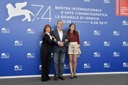 """Actress Ariane Ascaride (L), French director Robert Guediguian and actress Anais Demoustier attend the photocall of the movie """"La Villa"""" (The House by the sea) presented in competition at the 74th Venice Film Festival on September 3, 2017 at Venice Lido.  / AFP PHOTO / Tiziana FABI"""