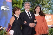 """Actress Ariane Ascaride (L), French director Robert Guediguian and actress Anais Demoustier attend the premiere of the movie """"La Villa"""" (The House by the sea) presented in competition at the 74th Venice Film Festival on September 3, 2017 at Venice Lido.  / AFP PHOTO / Filippo MONTEFORTE"""