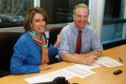 Speaker of the House Nancy Pelosi (D-CA) (L) and Democratic Congressional Campaign Committee Chairman Rep. Chris Van Hollen (D-MD) pose for photographers at the Democratic National Committee headquarters on the day of Midterm elections November 2, 2010 in Washington, DC. Most polling done ahead of today's elections point to a change in power in the House, where Republicans could win the 39 seats they need to take control of the chamber.