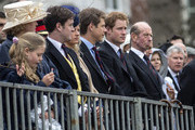Prince Harry (2nd R) and Prince Edward, Duke of Kent (R) watch Queen Elizabeth II as she presents the Household Cavalry with new standards at Horse Guards Parade, on May 28, 2014 in London, Untied Kingdom.