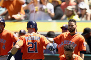 Derek Fisher #21 of the Houston Astros is congratulated by Jose Altuve #27 after he hit a home run in the seventh inning against the Oakland Athletics at Oakland Alameda Coliseum on May 9, 2018 in Oakland, California.