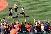 Adam Jones #10 of the Baltimore Orioles throws a baseball to the crowd before the start of the Orioles game against the Houston Astros at Oriole Park at Camden Yards on September 30, 2018 in Baltimore, Maryland.