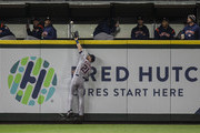 Leftfielder Derek Fisher #21 of the Houston Astros catches a fly ball at the wall hit by Jean Segura #2 of the Seattle Mariners during the fifth inning of a game at Safeco Field on April 18, 2018 in Seattle, Washington.