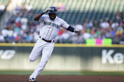 Denard Span #4 of the Seattle Mariners holds onto his helmet as he makes it to third on a triple against Charlie Morton #50 of the Houston Astros in the first inning at Safeco Field on July 31, 2018 in Seattle, Washington.