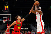 James Harden #13 of the Houston Rockets shoots a three-point basket against Trae Young #11 of the Atlanta Hawks in the first half at State Farm Arena on January 08, 2020 in Atlanta, Georgia.  NOTE TO USER: User expressly acknowledges and agrees that, by downloading and/or using this photograph, user is consenting to the terms and conditions of the Getty Images License Agreement.