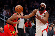 James Harden #13 of the Houston Rockets draws a foul as he drives against Paul Watson Jr. #2 of the Atlanta Hawks in the first half at State Farm Arena on January 08, 2020 in Atlanta, Georgia.  NOTE TO USER: User expressly acknowledges and agrees that, by downloading and/or using this photograph, user is consenting to the terms and conditions of the Getty Images License Agreement.