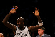 Kevin Garnett #2 of the Brooklyn Nets breaks free from the hold after he and Dwight Howard of the Houston Rockets got into a scuffle in the first quarter at the Barclays Center on January 12, 2015 in the Brooklyn borough of New York City. NOTE TO USER: User expressly acknowledges and agrees that, by downloading and/or using this photograph, user is consenting to the terms and conditions of the Getty Images License Agreement.