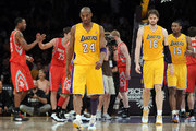 Kobe Bryant #24 of the Los Angeles Lakers, Pau Gasol #16 and Metta World Peace #15 leave the court after losing to the Houston Rockets 112-107 at Staples Center on April 6, 2012 in Los Angeles, California.  NOTE TO USER: User expressly acknowledges and agrees that, by downloading and or using this photograph, User is consenting to the terms and conditions of the Getty Images License Agreement.