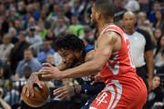 Derrick Rose #25 of the Minnesota Timberwolves drives to the basket against Eric Gordon #10 of the Houston Rockets during the fourth quarter in Game Three of Round One of the 2018 NBA Playoffs on April 21, 2018 at the Target Center in Minneapolis, Minnesota. The Timberwolves defeated 121-105. NOTE TO USER: User expressly acknowledges and agrees that, by downloading and or using this Photograph, user is consenting to the terms and conditions of the Getty Images License Agreement.